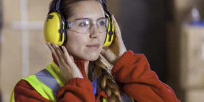 Woman wearing PPE (personal protection equipment)