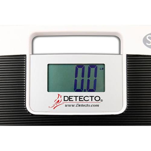 """<p>The SlimPRO digital low-profile scale's extra wide 17"""" x 14.5"""" / 43 cm x 37 cm platform accomodates all size of patients and the large 1.5"""" / 38 mm high digits on the LCD are easy to read. The SlimPro's high 440 lb / 220 kg capacity allows for bariatric weighing with an accuracy of 0.2 lb / 100 g increments. The SlimPRO features a built-in carrying handle for portability, 5 second weight hold, foot pads for weighing on any surface (even carpets), 4 AAA batteries (included), Auto On/Off, pounds-kilograms units switching, easy-to-clean surface, and low profile 1.4"""" / 36 mm slim depth for easy step on weighing. The scale's RS232 serial port allows connectivity with Detecto's optional P50 thermal tape printer or EMR/EHR software. With the serial connection, you may print on stable weight or send the data to a PC.<br /><br /><strong>Features<br /></strong></p> <ul> <li>1 RS232 serial port</li> <li>1.5"""" high LCD digits</li> <li>440 lb / 220 kg capacity</li> <li>5 second weight hold</li> <li>Integral carrying handle</li> <li>Low-profile design</li> <li>Swivel feet for weighing on carpets</li> </ul> <p><strong><br />Specifications<br /></strong></p> <ul> <li><strong>Capacity:</strong>440 lb x 0.2 lb / 200 kg x 100 g</li> <li><strong>Display:</strong>Four digit, seven segment LCD display with 1.5 in / 3.8 cm high digits</li> <li><strong>Display Area Size:</strong>3.15 in W x 1.6 in H / 8 cm W x 4 cm H</li> <li><strong>Overall Dimensions:</strong>17 in W x 14.5 in D x 1.4 in H / 43 cm W x 37 cm D x 3 cm H</li> <li><strong>Connectivity Port:</strong>RS232 serial output (requires optionally purchased interface cable: Part No. 6600-1940)</li> <li><strong>Power:</strong>4 1.5V AAA alkaline batteries (included)</li> <li><strong>Enclosure Construction:</strong>Polycarbonate</li> <li><strong>Units:</strong>Kilograms, Pounds</li> <li><strong>Features:</strong>Auto-On / Auto-Off / Low Battery Indicator</li> <li><strong>Shipping Weight:</strong>5 lb / 2.3 kg</li> </ul>"""